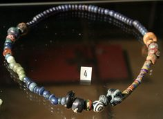 Necklace with glass pearls / beads, from the Viking age. Found in Sogndal, Western Norway. Exhibited at Bergen museum.