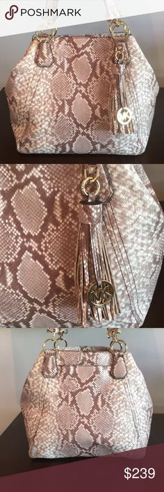 ⭐️MICHAEL KORS LARGE PYTHON SHOULDER BAG 💯AUTH MICHAEL KORS LARGE LOVELY PYTHON EMBOSSED SHOULDER BAG 100% AUTHENTIC. STUNNING AND STYLISH ALWAYS ON TREND! ONLY USED TWICE! WHAT A BEAUTIFUL BAG! IT HAS A WONDERFUL OUTSIDE POCKET. THIS LARGE BAG HAS BOTH A CLASP AND MAGNET CLASP CLOSURE. INSIDE THE LARGE MAIN COMPARTMENT ARE 5 ROOMY WALL POCKETS. ONE IS ZIP TOP CLOSURE. THE BAG MEASURES 17 INCHES WIDE BY 11.5 INCHES TALL! THE SHOULDER STRAP HAS A 9 INCH DROP. . IT IS MULTICOLORED BROWN…