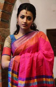 "Trisha latest beautiful sarees in ""yenthavaadu gaani"" movie. The cute tamil actress is gorgeous in plain multi color sarees in the telugu dubbed tamil movi Beautiful Girl Indian, Beautiful Saree, Beautiful Indian Actress, Beautiful Actresses, Beautiful Women, Beautiful Celebrities, Trisha Saree, Trisha Actress, Trisha Photos"