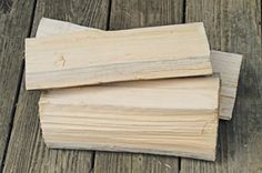 Split wood dries faster.  No wider than six  inches is what the EPA recommends.