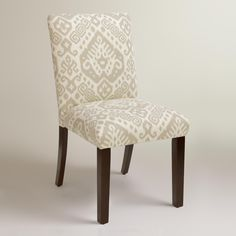 Featuring a modern silhouette designed for comfort, our custom-made dining chair is handcrafted in the U.S.A. of solid pine wood with a khaki ikat motif and smooth linen blend upholstery. Accentuate your dining decor with this fashion-forward side chair, mix with your current chairs, or pair it with a vanity or accent table.