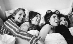 Love these four women. Girls. NY. Four in the bed.
