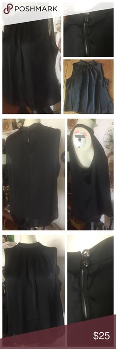 "NWOT Black Satiny Sleeveless Blouse ~ Petite XL Lovely sleeveless silky black blouse with subtle gathering at the mandarins collar neckline and two buttons in the back ~ ELEMENTZ Petites XL. 100% polyester. Measured flat: pit-to-pit across bust 21-1/2""; from shoulder to bottom hem 22"". In excellent, NWOT condition. Smoke-free home. ELEMENTZ Tops Blouses"