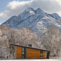 Tour this incredible modern home in Utah situated on a pristine pasture with an inspiring view of Mount Olympus as a backdrop.