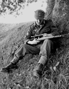 A German sniper from a Gebirgsjäger unit (Mountain Riflemen) cleans his rifle during the Italian Campaign on the Gothic Line along the summits of the Apennines. Emilia-Romagna, Italy. September 1944.