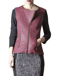 Be minimalist chic with this burgundy and black leather jacket!  The black sleeves are stretchy, so that you can slip in it easily, and it is a nice contrast to the soft buttery burgundy leather.  -AS by DF