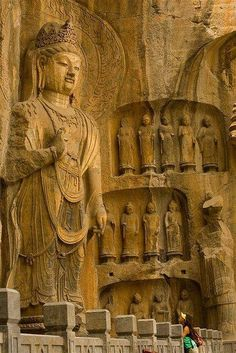 A collection of Buddha statues at the Longmen Caves in the Henan province, China.