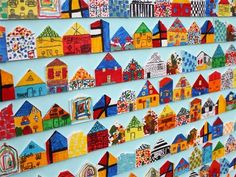 "Balsa wood houses decorated by every student to create a ""community"" image. Idea for auction."