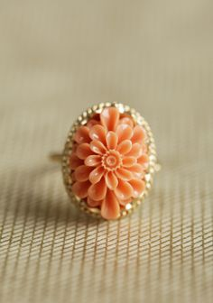 "Sweet Orange Flower Ring 15.99 at shopruche.com. This darling flower ring surrounded by gold toned filigree and a rope detail is the perfect accessory for any outfit.1"" flower"