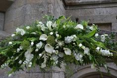White and Green Calla lily arch by Tracy Qs Cornwall Wedding Flowers