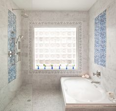 Making the most of a small space, the tub is in the shower enclosure -- cute and brilliant. Spa Inspired Bathroom, Bathroom Spa, Shower Enclosure, Luxury Interior Design, Design Firms, Bathroom Inspiration, Master Bath, Small Spaces, Bath Ideas