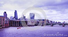 A view of the Thames and the river bank  in the city of London.