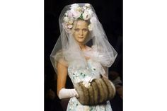 A model in a green wedding gown embroidered with flower patterns designed by Oscar de la Renta in 2000 in Paris.