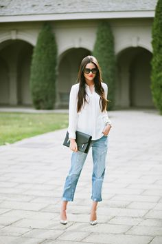 Shop this look for $111:  http://lookastic.com/women/looks/white-button-down-shirt-and-blue-boyfriend-jeans-and-black-clutch-and-grey-heels/1494  — White Silk Button Down Shirt  — Blue Boyfriend Jeans  — Black Leather Clutch  — Grey Print Leather Heels
