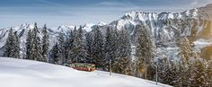 Interlaken Switzerland Its surrounding mountains, with dense forests, alpine meadows and glaciers, has numerous hiking and skiing trails.  Shawn Frank