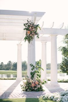 wedding ceremony at the lakeside gazebo featured grand columns ...