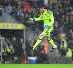Manchester United's David De Gea celebrates after teammate Marcus Rashford had…