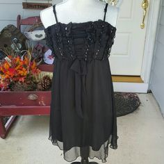 Little black dress  Gently worn. No tears or obvious signs of wear. Has beautiful beaded work on the front. Can be worn as a dress or as a long shirt with cute leggings stylebook Dresses Mini