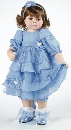 Andelyn is costumed in an adorable Wedgewood blue layered party dress with flower accents she is stunning!