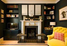 Dark snug living room. Yellow armchair. Acres Farm fender, bespoke shelves, antique mirror. Talia Cobbold Interior Design. Yellow Armchair, Signature Style, Shelves, Living Room, Interior Design, Bespoke, Snug, Antique, Mirror