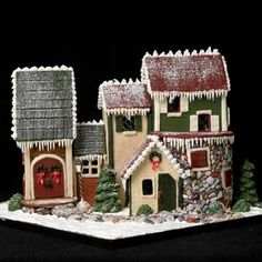 Rolled fondant was pressed onto a textured suface to mimic the pattern of siding and shutters. Powdered sugar was dusted over top.  |  Created for the The National Gingerbread House Competition and Display at The Grove Park Inn in Asheville, NC.