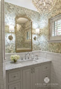pretty floral wallpaper, duck egg blue, chandelier, sconces, mirror, vanity, marble