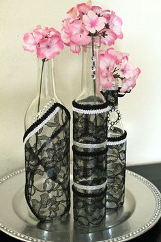 Decorated Wine Bottle Centerpiece Black Lace, White & Silver / http://www.himisspuff.com/blush-and-black-wedding-ideas/5/