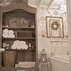 An ugly duckling bathroom was taken down to the studs and transformed and enlarged into a French cottage bathroom.