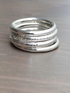 Stacking Rings, Thick Sterling Silver Four Stacking Rings, Textured Rings, Unisex Rings, Free Worldwide Shipping by HotTorStudio on Etsy https://www.etsy.com/listing/229780342/stacking-rings-thick-sterling-silver