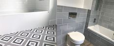 Discover rustic to modern tiling patterns with the top 60 best grey bathroom tile ideas. Explore neutral interior wall and floor designs. Neutral Bathroom Tile, Small Bathroom Colors, Bathroom Tile Designs, Grey Bathrooms, Bathroom Interior Design, Bathroom Flooring, Bathroom Ideas, Shower Ideas, Bathroom Tiling