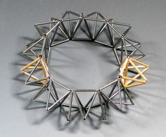 Bracelet made from tubes of oxidized sterling silver and 14kt gold, joined into a chain of tetrahedrons  #geometric  #jewelry  #bracelet  #tetrahedron