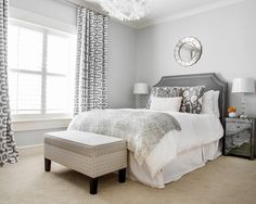 This is an example of a transitional bedroom in Little Rock with gray walls and carpet.