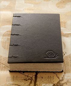Chunky book by Zoopress studio, via Flickr. Case in goat leather with embossed logo. Coptic sewing with linen thread.