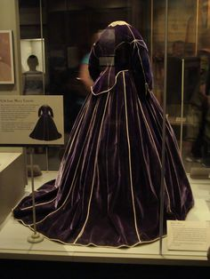 Mary Todd Lincoln's Dress:  Smithsonian Museum Washington DC.  Mary Lincoln's purple velvet skirt and daytime bodice are believed to have been made by African American dressmaker Elizabeth Keckly. The first lady wore the gown during the Washington winter social season in 1861–62. Both pieces are piped with white satin, and the bodice is trimmed with mother-of pearl buttons. An evening bodice was included with the ensemble. The lace collar is of the period, but not original to the dress.