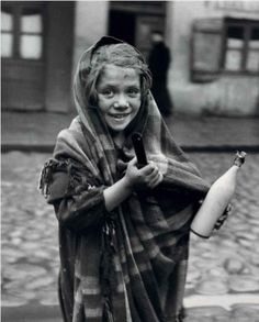 """""""Father earned today some money and daughter is sent for milk, [[MORE]] Photo by Roman Vishniac - a Russian-American photographer, best known for capturing on film the culture of Jews in Central and Eastern Europe before the Holocaust Vintage Photographs, Vintage Photos, Antique Photos, Lewis Hine, Russian American, Central And Eastern Europe, Jewish History, Black White, Portraits"""