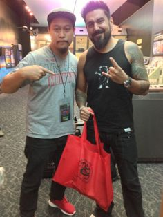 Mithra's Wayne Reyes with Stefano Alcantara - while at the 2013 United Ink Tattoo Convention in NY.