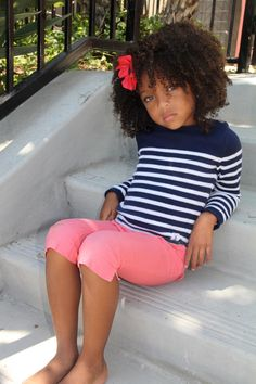 So cute... love the way she's rocking the natural hair :-)