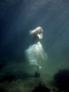They forced her last step to the bottom of the sea.  There she is waiting for her love, to come set her free...