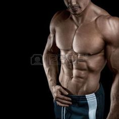 shirtless: Muscular and fit young bodybuilder #fitness male model posing over black background. Studio shot on black background. #BodybuildingDiet,