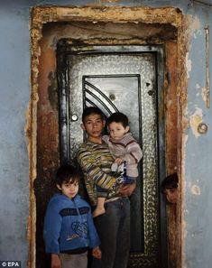 Children stand in an apartment block on Horea Street in Craica, Baia Mare, Romania.