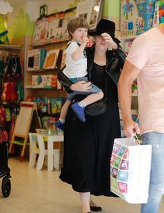 Adele was photographed enjoying a day with her son Angelo at a toy store in Barcelona, Spain on Tuesday (May 24). The singer was dressed in a black maxi dress that she paired with a motorcycle jacket, a matching hat and flats. She kept a low profile while browsing the shop with the