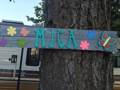 Beautiful sign I made from pallet wood, wooden and painted letters and wooden flowers and butterfly.  This is for my even more beautiful grand daughter, Mica.