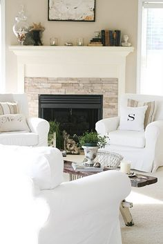 Love the idea of a conversation room, 4 white chairs around a small table. So cozy and inviting!