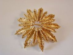 Vintage AVON Starburst Brooch - Brilliant Goldtone Textured Finish - Statement Piece from 70s on Etsy, $10.00