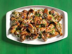 Get this all-star, easy-to-follow Spicy Pesto Wings recipe from Eddie Jackson