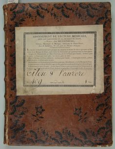 I came across this book in our Performing Arts Antiquarian Collection last week. The book is a score of Jean Joseph Mondonville's opera Titon et L'Aurore published in Paris in 1753 (M1500 .M745ti 1753). The label on the front is from a French subscription library (of unknown date at the moment), what I'm curious about is the pattern on the leather itself.
