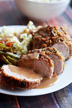 Walnut-Crusted Pork Tenderloin with Apple Cider Gravy.  Succulent, delicious, impressive, and surprisingly easier than you'd think.  Serve it with the Goat Cheese Chive Mashed Potatoes! | hostthetoast.com