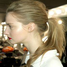 Softly textured pony + luminous skin + a bold lip = best 'desk to drinks' look ever.   House of Holland AW11/12 Backsatge: Undone Ponytail Hair Trend