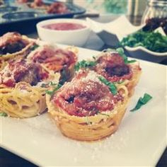 Spaghetti and Meatballs Muffin Bites | This recipe turns the traditional meal into party-ready, individual servings of spaghetti and meatballs muffin bites.