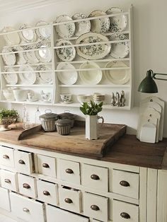 love the plate racks & cabinet -maybe TAC can take that old book shelf and put it up on the wall after he sizes it to fit and then I can display my china.